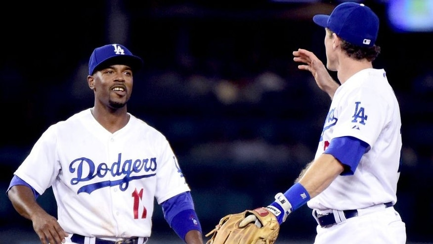 LOS ANGELES, CA - SEPTEMBER 23: Jimmy Rollins #11 and Chase Utley #26 of the Los Angeles Dodgers celebrate a 4-1 win over the Arizona Diamondbacks at Dodger Stadium on September 23, 2015 in Los Angeles, California. (Photo by Harry How/Getty Images)
