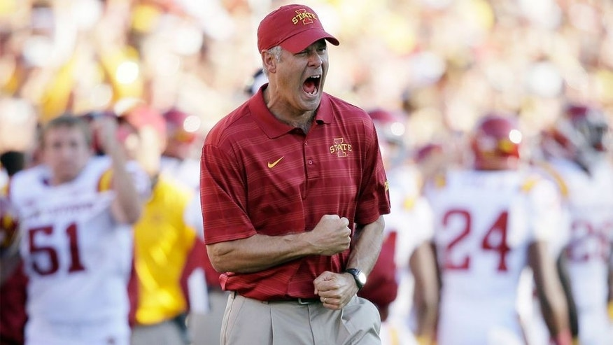Iowa State head coach Paul Rhoads reacts after a touchdown during the second half of an NCAA college football game against Iowa, Saturday, Sept. 13, 2014, in Iowa City, Iowa. Iowa State won 20-17. (AP Photo/Charlie Neibergall)