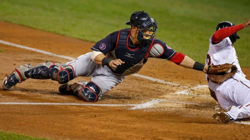 <p>Sep 24, 2015; Minneapolis, MN, USA; Cleveland Indians catcher Yan Gomes (10) tags out Minnesota Twins center fielder Aaron Hicks (32) in the first inning at Target Field. Mandatory Credit: Bruce Kluckhohn-USA TODAY Sports</p>