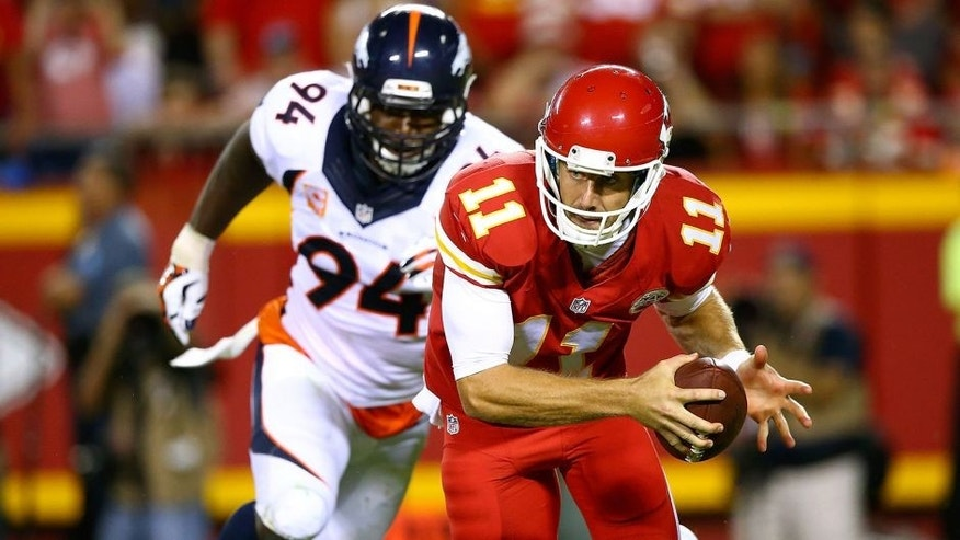 KANSAS CITY, MO - SEPTEMBER 17: Alex Smith #11 of the Kansas City Chiefs avoids the rush of DeMarcus Ware #94 of the Denver Broncosduring the game at Arrowhead Stadium on September 17, 2015 in Kansas City, Missouri. (Photo by Ronald Martinez/Getty Images)