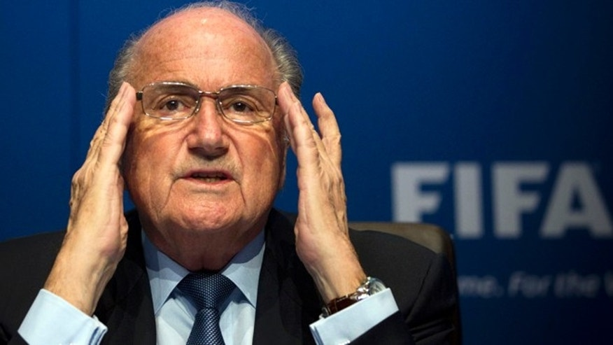 FILE - In this March 30, 2012 file photo FIFA President Sepp Blatter gestures during a press conference at the FIFA headquarters in Zurich, Switzerland. On Friday, Sept. 25, 2015 Swiss attorney general opened criminal proceedings against FIFA President Sepp Blatter.  (AP Photo/Anja Niedringhaus)