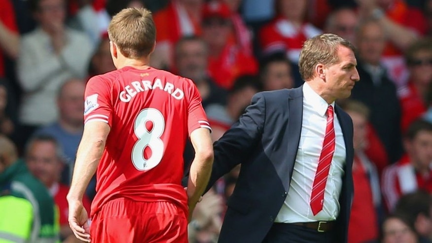 LIVERPOOL, ENGLAND - APRIL 27: Steven Gerrard of Liverpool shakes hands with Manager Brendan Rodgers of Liverpool at the end of the match during the Barclays Premier League match between Liverpool and Chelsea at Anfield on April 27, 2014 in Liverpool, England. (Photo by Clive Brunskill/Getty Images)