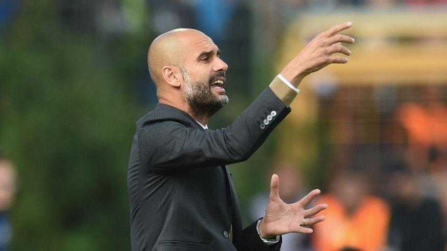 DARMSTADT, GERMANY - SEPTEMBER 19: Josep Guardiola, head coach of Muenchen reacts during the Bundesliga match between SV Darmstadt 98 and FC Bayern Muenchen at Merck-Stadion am Boellenfalltor on September 19, 2015 in Darmstadt, Germany. (Photo by Matthias Hangst/Bongarts/Getty Images)