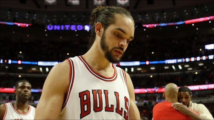 <p>Chicago Bulls center Joakim Noah (13) walks off the court after Game 6 against the Cleveland Cavaliers in a second-round NBA basketball playoff series in Chicago on Thursday, May 14, 2015. The Cavaliers won 94-73. (AP Photo/Nam Y. Huh)</p>
