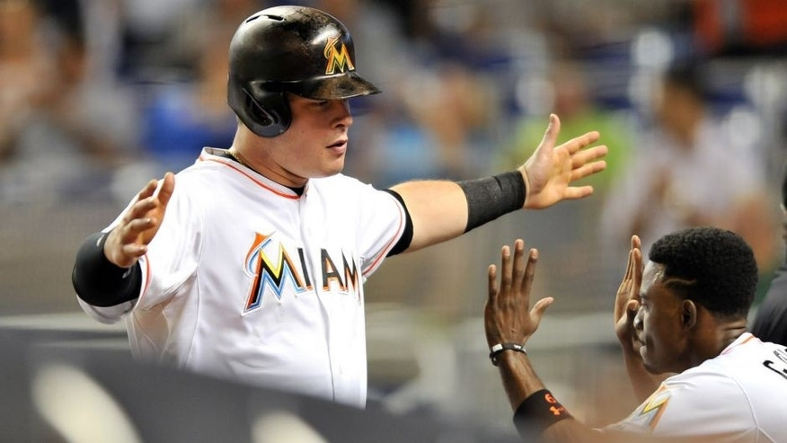 Sep 25, 2015; Miami, FL, USA; Miami Marlins second baseman Dee Gordon (right) celebrates after Miami Marlins first baseman Justin Bour (left) hit a three run homer during the first inning against the Atlanta Braves at Marlins Park. Mandatory Credit: Steve Mitchell-USA TODAY Sports