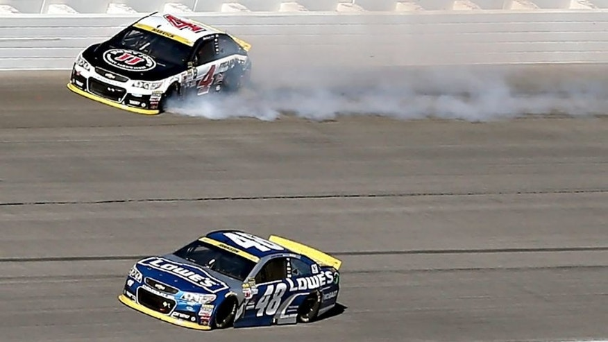 JOLIET, IL - SEPTEMBER 20: Kevin Harvick, driver of the #4 Jimmy John's / Budweiser Chevrolet, spins after contact with Jimmie Johnson, driver of the #48 Lowe's Chevrolet, during the NASCAR Sprint Cup Series myAFibRisk.com 400 at Chicagoland Speedway on September 20, 2015 in Joliet, Illinois. (Photo by Jonathan Daniel/Getty Images)