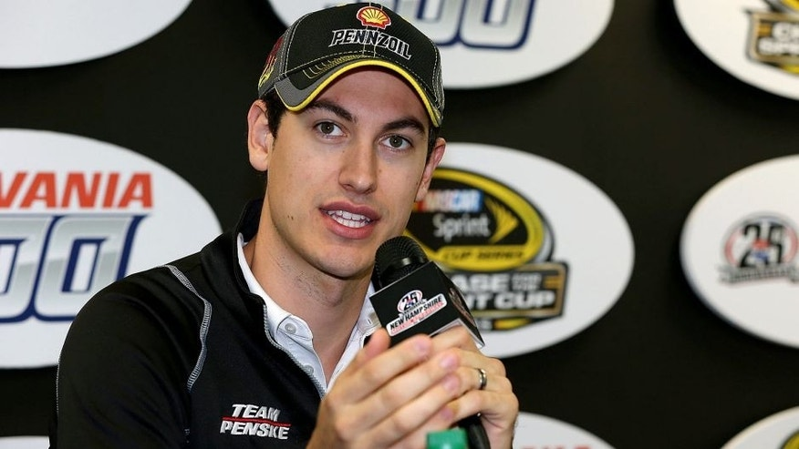 LOUDON, NH - SEPTEMBER 25: Joey Logano, driver of the #22 Shell Pennzoil Ford, speaks with the media during practice for the NASCAR Sprint Cup Series Sylvania 300 at New Hampshire Motor Speedway on September 25, 2015 in Loudon, New Hampshire. (Photo by Todd Warshaw/NASCAR via Getty Images)