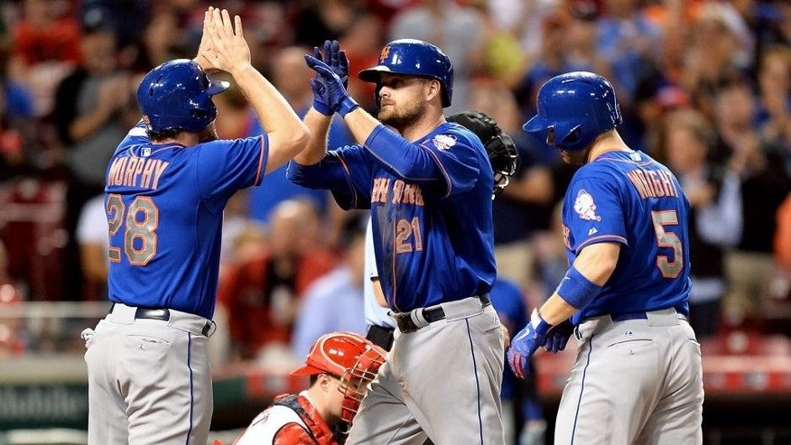 CINCINNATI, OH - SEPTEMBER 25: Lucas Duda #21 of the New York Mets celebrates at home plate with Daniel Murphy #28 of the New York Mets and David Wright #5 of the New York Mets after hitting the second of his two three-run home runs in the seventh inning against the Cincinnati Reds at Great American Ball Park on September 25, 2015 in Cincinnati, Ohio. New York defeated Cincinnati 12-5. (Photo by Jamie Sabau/Getty Images)