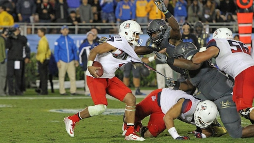 <p>November 2, 2014: Arizona quarterback Anu Solomon cant' avoid the swarm of UCLA defenders.</p>