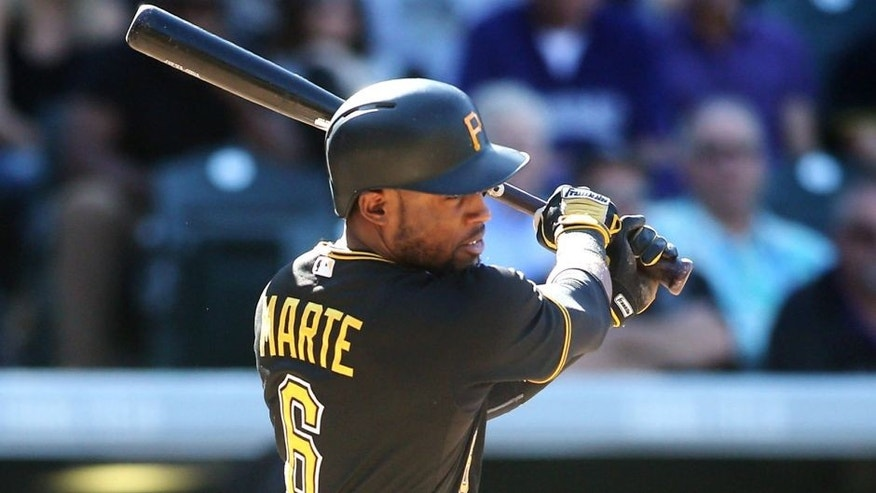 Sep 24, 2015; Denver, CO, USA; Pittsburgh Pirates left fielder Starling Marte (6) hits a single during the eighth inning against the Colorado Rockies at Coors Field. The Pirates won 5-4. Mandatory Credit: Chris Humphreys-USA TODAY Sports