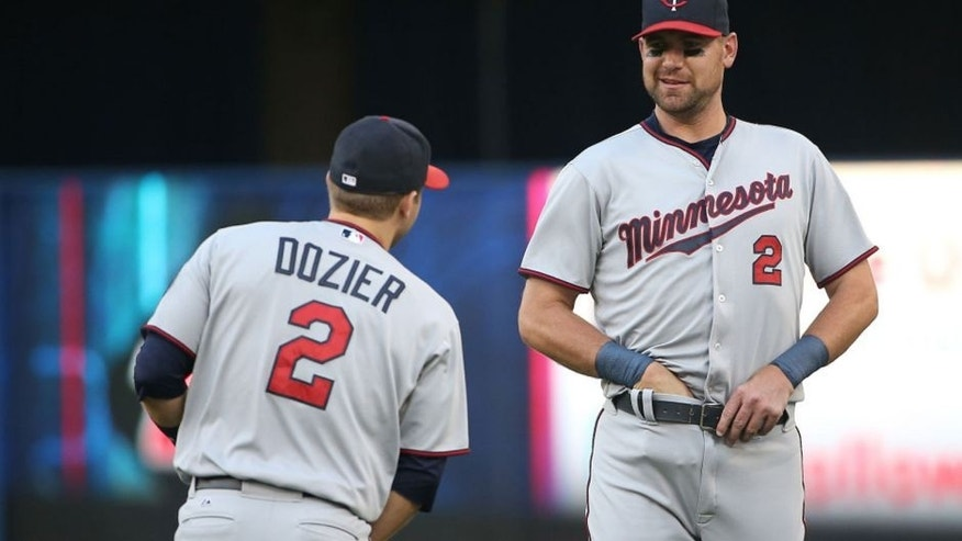 <p>TORONTO, CANADA - AUGUST 5: Brian Dozier #2 (L) of the Minnesota Twins is pranked by Mike Pelfrey #37 (R) who wears a Brian Dozier jersey as both players stretch before teh start of MLB game action against the Toronto Blue Jays on August 5, 2015 at Rogers Centre in Toronto, Ontario, Canada. (Photo by Tom Szczerbowski/Getty Images) ORG XMIT: 538588123 ORIG FILE ID: 483046608</p>