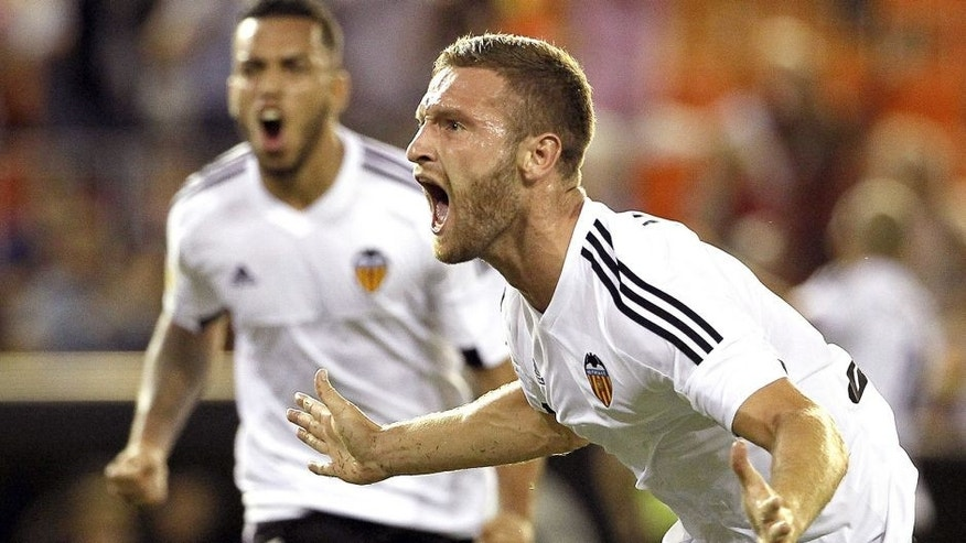 Valencia's German defender Shkodran Mustafi celebrates his goal during the Spanish league football match Valencia CF vs Granada CF at the Mestalla stadium in Valencia on September 25, 2015. AFP PHOTO / JOSE JORDAN (Photo credit should read JOSE JORDAN/AFP/Getty Images)