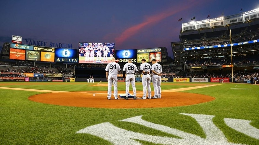 Sep 24, 2015; Bronx, NY, USA; New York Yankees catchers and former catcher and present manger Joe Girardi (28) stand at home plate during a moment of silence in honor of former New York Yankee catcher Yogi Berra who passed away this week prior to the game between the New York Yankees and Chicago White Sox at Yankee Stadium. Mandatory Credit: Andy Marlin-USA TODAY Sports
