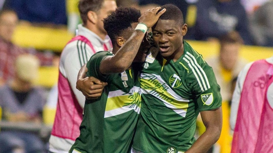 Sep 26, 2015; Columbus, OH, USA; Portland Timbers forward Fanendo Adi (9) celebrates his game winning goal with defender midfielder Rodney Wallace (22) in the second half of the game against the Columbus Crew SC at MAPFRE Stadium. The Portland Timbers beat the Columbus Crew SC 2-1. Mandatory Credit: Trevor Ruszkowski-USA TODAY Sports