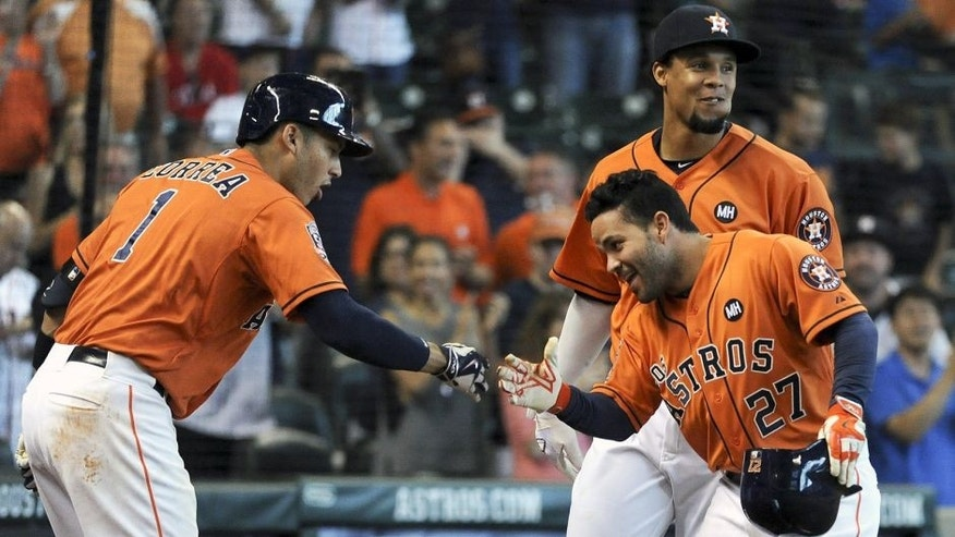HOUSTON, TX - SEPTEMBER 26: Jose Altuve #27 of the Houston Astros celebrates his solo home run with Carlos Correa #1 during the eighth inning against theTexas Rangers at Minute Maid Park on September 26, 2015 in Houston, Texas. (Photo by Eric Christian Smith/Getty Images)