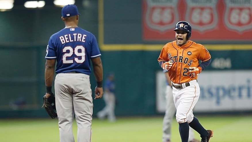 Sep 26, 2015; Houston, TX, USA; Houston Astros second baseman Jose Altuve (27) remarks to Texas Rangers third baseman Adrian Beltre (29) while rounding the bases after hitting a home run in the third inning at Minute Maid Park. Mandatory Credit: Thomas B. Shea-USA TODAY Sports