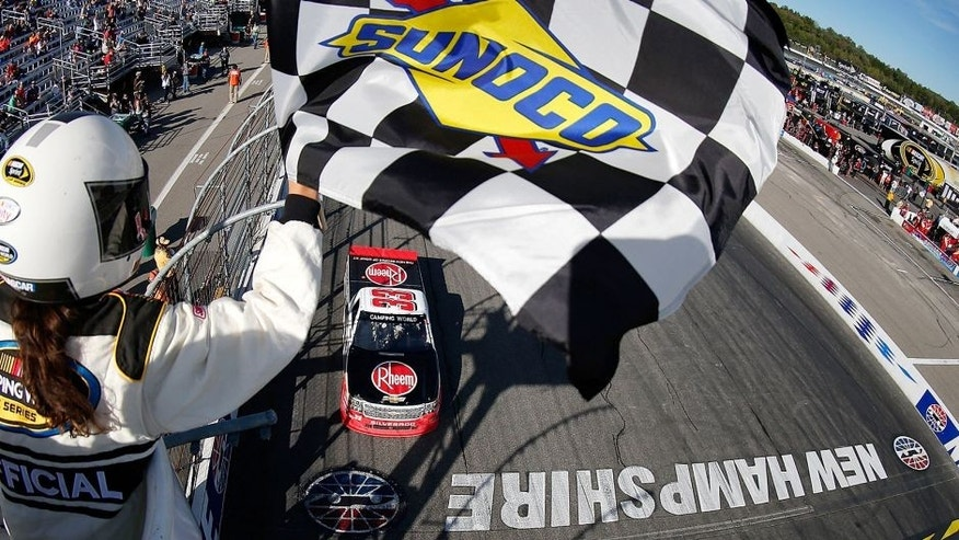 LOUDON, NH - SEPTEMBER 26: Austin Dillon, driver of the #33 Rheem Chevrolet, takes the checkered flag to win the NASCAR Camping World Truck Series UNOH 175 at New Hampshire Motor Speedway on September 26, 2015 in Loudon, New Hampshire. (Photo by Todd Warshaw/NASCAR via Getty Images)