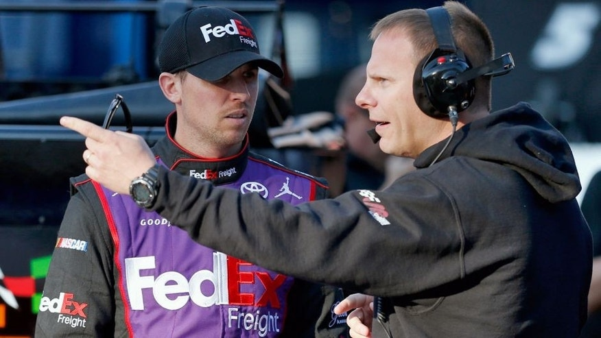 BRISTOL, TN - APRIL 18: Denny Hamlin, driver of the #11 FedEx Freight Toyota, talks to his crew chief, Dave Rogers, in the garage area during practice for the NASCAR Sprint Cup Series Food City 500 at Bristol Motor Speedway on April 18, 2015 in Bristol, Tennessee. (Photo by Todd Warshaw/NASCAR via Getty Images)