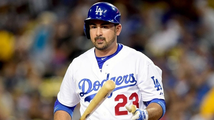 LOS ANGELES, CA - SEPTEMBER 14: Adrian Gonzalez #23 of the Los Angeles Dodgers reacts to his strikeout to end the first inning at Dodger Stadium on September 14, 2015 in Los Angeles, California. (Photo by Harry How/Getty Images)