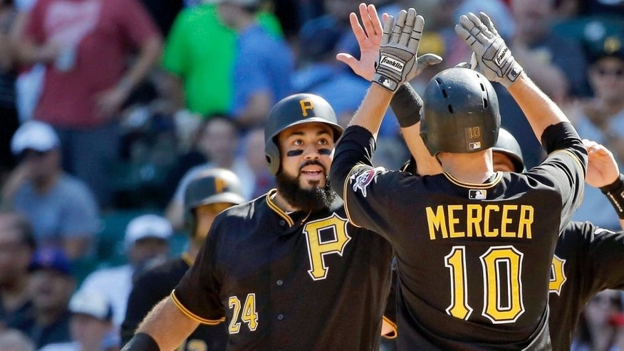 CHICAGO, IL - SEPTEMBER 26: Pedro Alvarez #24 of the Pittsburgh Pirates congratulates Jordy Mercer #10 for hitting a three run home run against the Chicago Cubs during the fifth inning at Wrigley Field on September 26, 2015 in Chicago, Illinois. (Photo by Jon Durr/Getty Images)