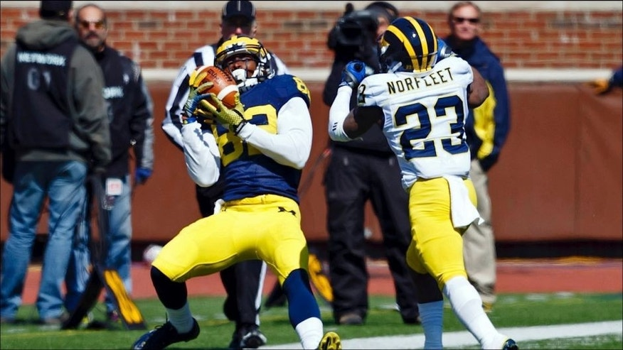 <p>Apr 4, 2015; Ann Arbor, MI, USA; Michigan Wolverine wide receiver Amara Darboh (82) makes a catch in front of wide receiver Dennis Norfleet (23) during the Spring football game at Michigan Stadium. Mandatory Credit: Rick Osentoski-USA TODAY Sports</p>