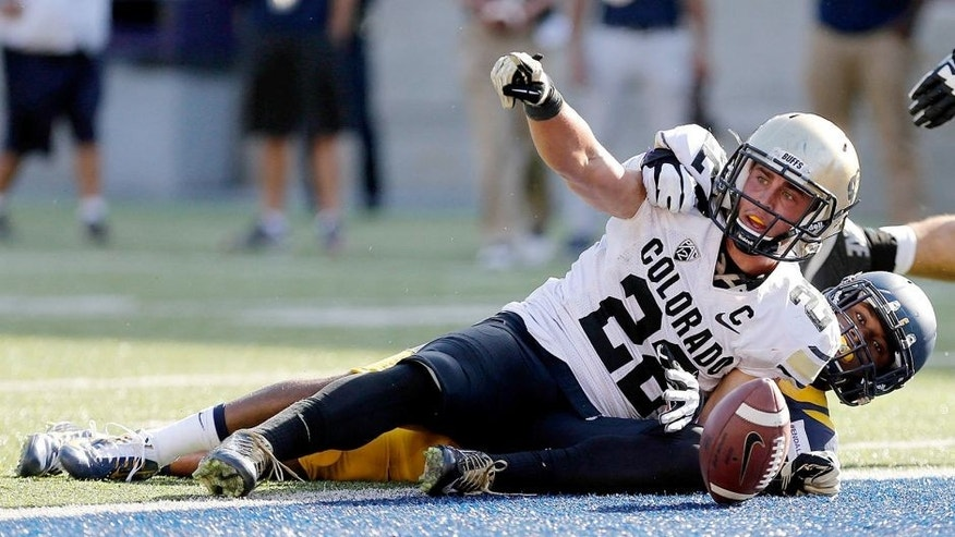 Sep 27, 2014; Berkeley, CA, USA; Colorado Buffaloes wide receiver Nelson Spruce (22) reacts after scoring a touchdown against the California Golden Bears during the fourth quarter at Memorial Stadium. The California Golden Bears defeated the Colorado Buffaloes 59-56 in double overtime. Mandatory Credit: Kelley L Cox-USA TODAY Sports