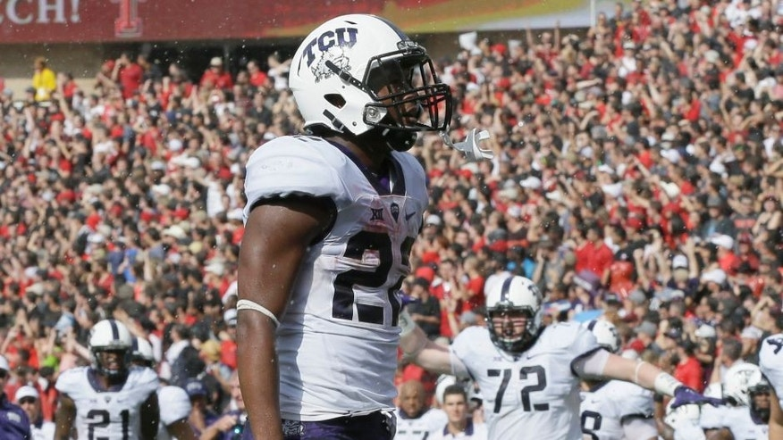 TCU running back Aaron Green celebrates scoring a touchdown during the first half of an NCAA college football game against Texas Tech, Saturday, Sept. 26, 2015, in Lubbock, Texas. (AP Photo/LM Otero)