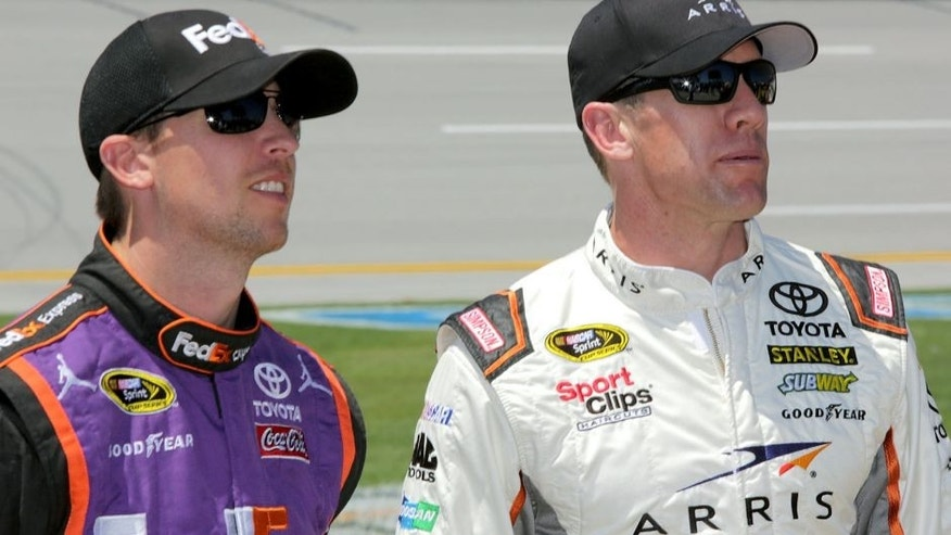 TALLADEGA, AL - MAY 02: Denny Hamlin, driver of the #11 FedEx Express Toyota, talks to Carl Edwards, driver of the #19 ARRIS Toyota, on the grid during qualifying for the NASCAR Sprint Cup Series GEICO 500 at Talladega Superspeedway on May 2, 2015 in Talladega, Alabama. (Photo by Jerry Markland/Getty Images)