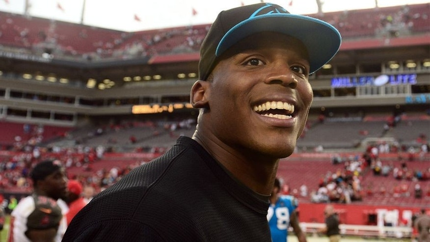 Sep 7, 2014; Tampa, FL, USA; Carolina Panthers quarterback Cam Newton (1) walks off the field after defeating Tampa Bay Buccaneers 20-14 at Raymond James Stadium. Mandatory Credit: Andrew Weber-USA TODAY Sports