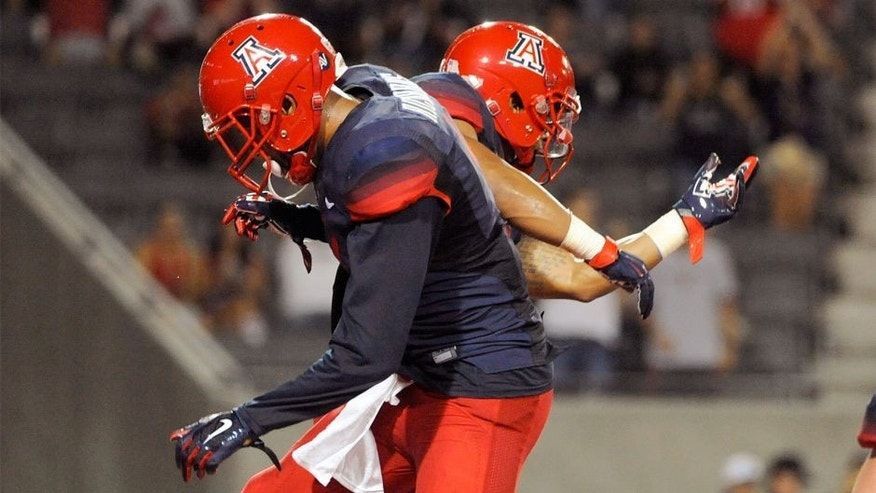 Sep 3, 2015; Tucson, AZ, USA; Arizona Wildcats wide receiver Nate Phillips (6) and wide receiver David Richards (4) (front) celebrate after scoring a touchdown during the third quarter against the Texas-San Antonio Roadrunners at Arizona Stadium. Arizona won 42-32. Mandatory Credit: Casey Sapio-USA TODAY Sports