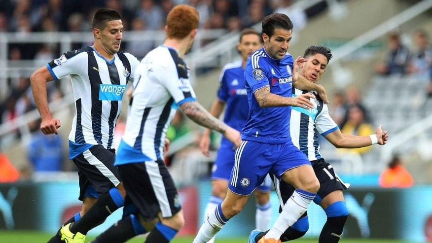 Chelseas Spanish midfielder Cesc Fabregas (2nd R) runs with the ball during the English Premier League football match between Newcastle United and Chelsea at St James' Park in Newcastle-upon-Tyne, north east England, on September 26, 2015. AFP PHOTO / IAN MACNICOL RESTRICTED TO EDITORIAL USE. No use with unauthorized audio, video, data, fixture lists, club/league logos or 'live' services. Online in-match use limited to 75 images, no video emulation. No use in betting, games or single club/league/player publications. (Photo credit should read Ian MacNicol/AFP/Getty Images)
