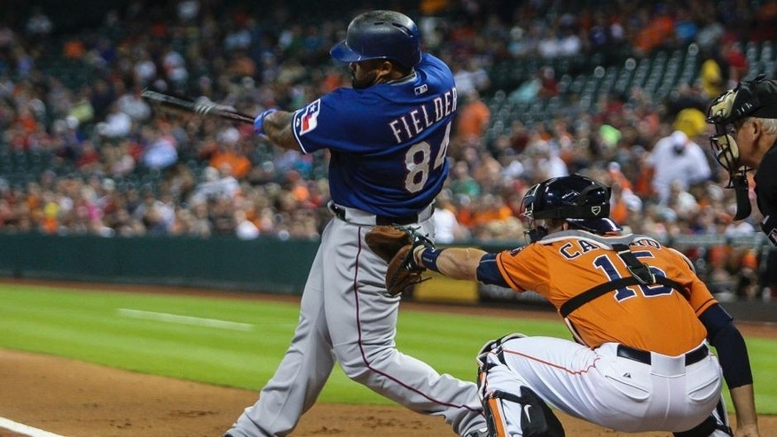Sep 25, 2015; Houston, TX, USA; Texas Rangers designated hitter Prince Fielder (84) hits an RBI double during the first inning against the Houston Astros at Minute Maid Park. Mandatory Credit: Troy Taormina-USA TODAY Sports