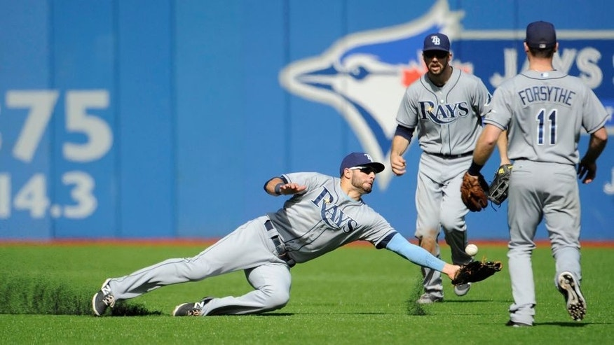 Sep 26, 2015; Toronto, Ontario, CAN; Tampa Bay Rays Kevin Kiermaier (39) is unable to catch a ball hit for a RBI double by Toronto Blue Jays center field Kevin Pillar (not pictured) in the third inning at Rogers Centre. Mandatory Credit: Peter Llewellyn-USA TODAY Sports