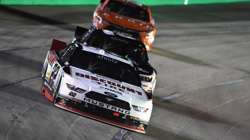 SPARTA, KY - SEPTEMBER 26: Ryan Blaney, driver of the #22 Discount Tire Ford, leads Brian Scott, driver of the #2 Shore Lodge Chevrolet, and Daniel Suarez, driver of the #18 ARRIS Toyota, during the NASCAR Xfinity Series Visitmyrtlebeach.com 300 at Kentucky Speedway on September 26, 2015 in Sparta, Kentucky. (Photo by Rainier Ehrhardt/NASCAR via Getty Images)