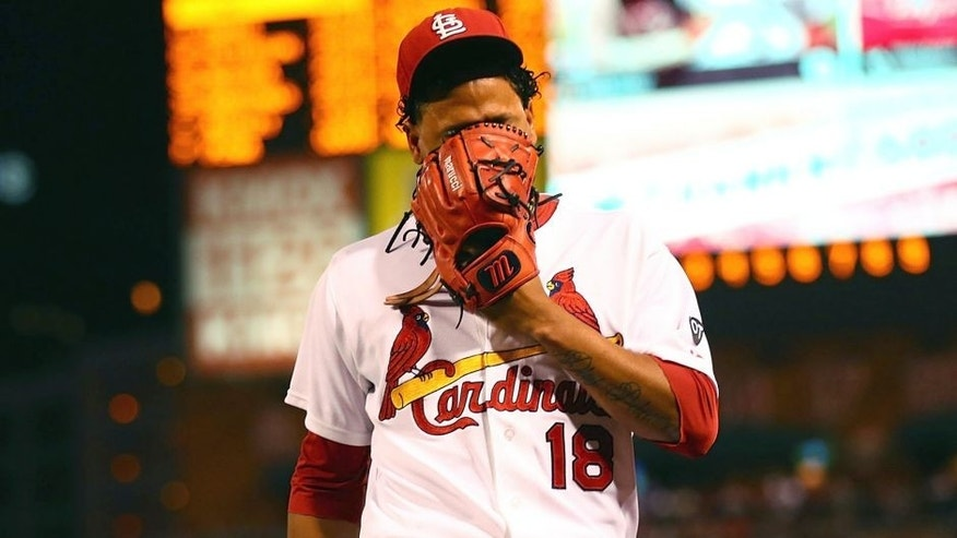 ST. LOUIS, MO - SEPTEMBER 25: Starter Carlos Martinez #18 of the St. Louis Cardinals reacts after being pulled from the game against the Milwaukee Brewers due to shoulder tightness in the first inning at Busch Stadium on September 25, 2015 in St. Louis, Missouri. (Photo by Dilip Vishwanat/Getty Images)