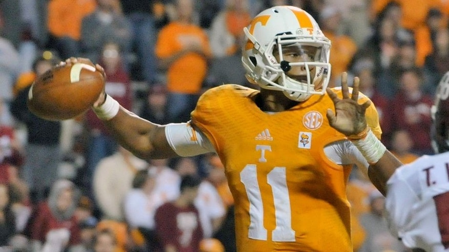Oct 25, 2014; Knoxville, TN, USA; Tennessee Volunteers quarterback Joshua Dobbs (11) passes against the Alabama Crimson Tide during the second half game at Neyland Stadium. Alabama won 34-20. Mandatory Credit: Jim Brown-USA TODAY Sports