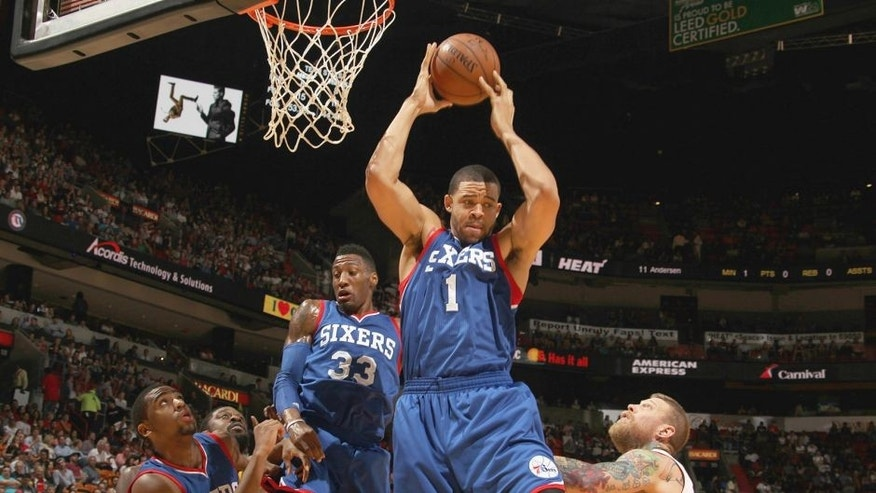 MIAMI, FL - FEBRUARY 23: JaVale McGee #1 of the Philadelphia 76ers grabs the rebound against the Miami Heat on February 23, 2015 at American Airlines Arena in Miami, Florida. NOTE TO USER: User expressly acknowledges and agrees that, by downloading and or using this Photograph, user is consenting to the terms and conditions of the Getty Images License Agreement. Mandatory Copyright Notice: Copyright 2015 NBAE (Photo by Issac Baldizon/NBAE via Getty Images)