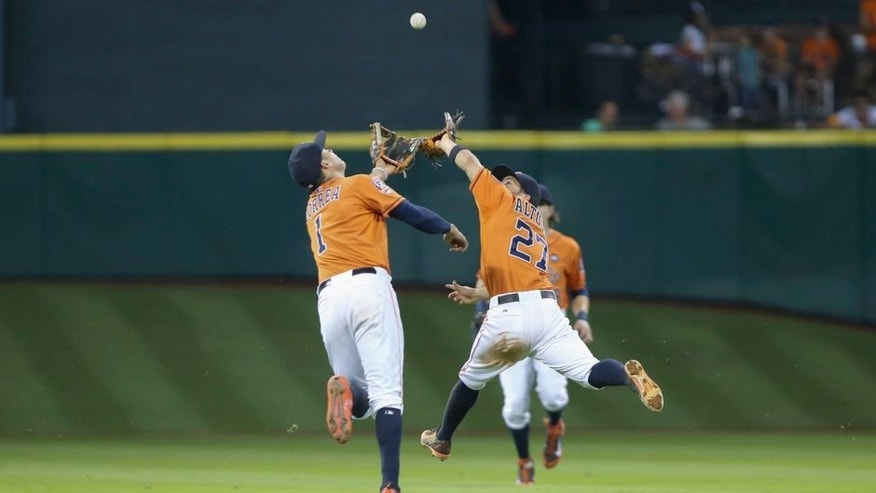 Sep 25, 2015; Houston, TX, USA; Houston Astros shortstop Carlos Correa (1) and second baseman Jose Altuve (27) collide attempting to catch a fly ball during the seventh inning against the Texas Rangers at Minute Maid Park. Mandatory Credit: Troy Taormina-USA TODAY Sports