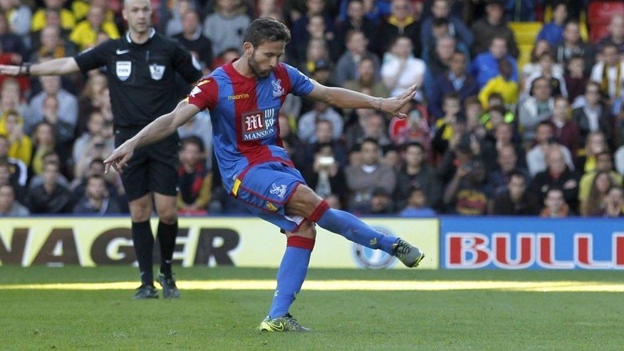 Crystal Palaces French midfielder Yohan Cabaye scores the opening goal from the penalty spot during the English Premier League football match between Watford and Crystal Palace at Vicarage Road Stadium in Watford, north of London on September 27, 2015. AFP PHOTO / IAN KINGTON RESTRICTED TO EDITORIAL USE. No use with unauthorized audio, video, data, fixture lists, club/league logos or 'live' services. Online in-match use limited to 75 images, no video emulation. No use in betting, games or single club/league/player publications. (Photo credit should read IAN KINGTON/AFP/Getty Images)