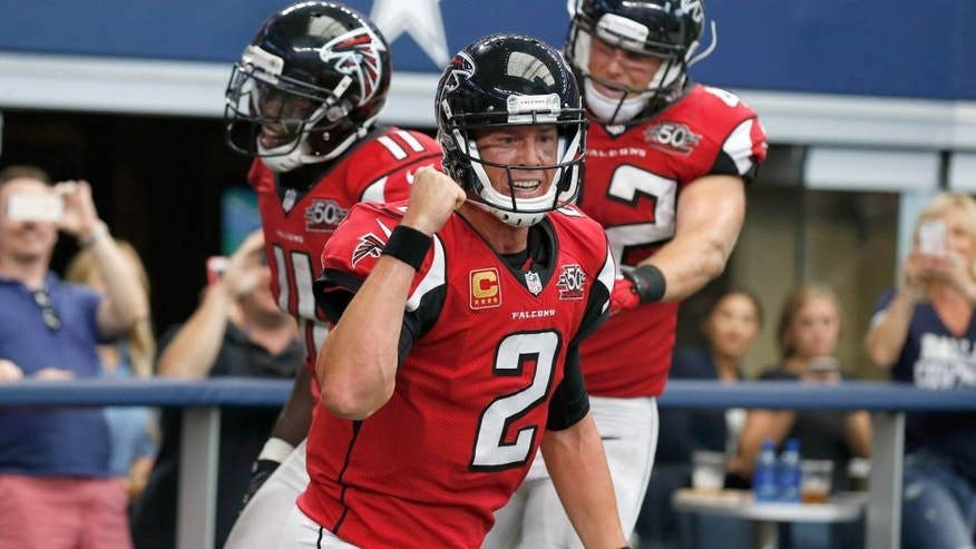 Sep 27, 2015; Arlington, TX, USA; Atlanta Falcons quarterback Matt Ryan (2) celebrates with receiver Julio Jones (11) and fullback Patrick MiMarco (42) after their fourth quarter touchdown against the Dallas Cowboys at AT&T Stadium. Mandatory Credit: Matthew Emmons-USA TODAY Sports