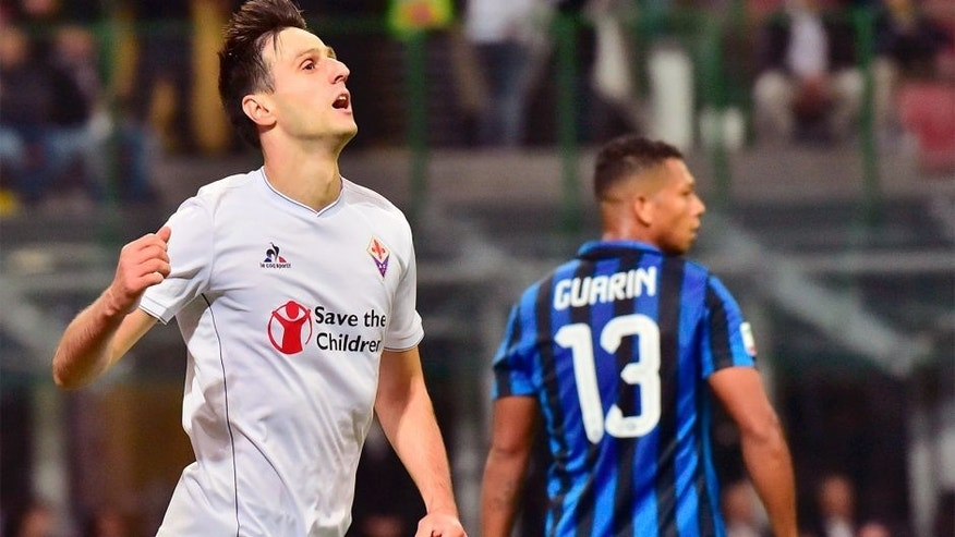 Fiorentina's Croatian forward Nikola Kalinic celebrates after scoring a goal during the Serie A football match between Inter Milan and Fiorentina at the San Siro Stadium in Milan on September 27, 2015 . AFP PHOTO / GIUSEPPE CACACE (Photo credit should read GIUSEPPE CACACE/AFP/Getty Images)
