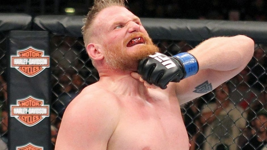 MILWAUKEE, WI - AUGUST 31: Josh Barnett celebrates after defeating Frank Mir in their UFC heavyweight bout at BMO Harris Bradley Center on August 31, 2013 in Milwaukee, Wisconsin. (Photo by Ed Mulholland/Zuffa LLC/Zuffa LLC via Getty Images)
