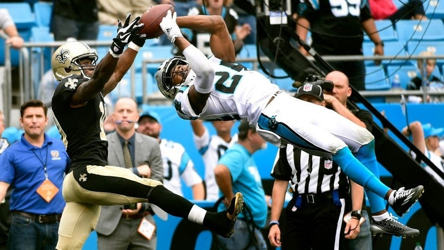 Sep 27, 2015; Charlotte, NC, USA; Carolina Panthers cornerback Josh Norman (24) intercepts a pass in the end zone intended for New Orleans Saints wide receiver Brandin Cooks (10) late in the fourth quarter. The Panthers defeated the Saints 27-22 at Bank of America Stadium. Mandatory Credit: Bob Donnan-USA TODAY Sports