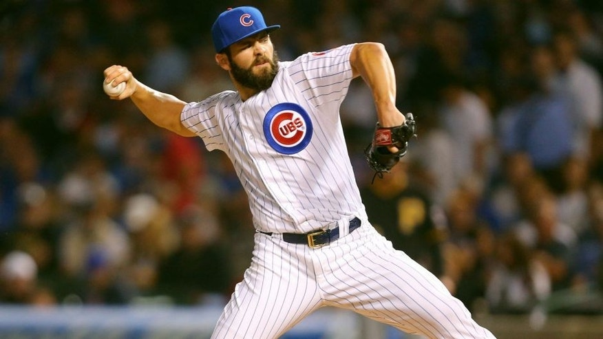 Sep 27, 2015; Chicago, IL, USA; Chicago Cubs starting pitcher Jake Arrieta (49) delivers a pitch during the first inning against the Pittsburgh Pirates at Wrigley Field. Mandatory Credit: Dennis Wierzbicki-USA TODAY Sports