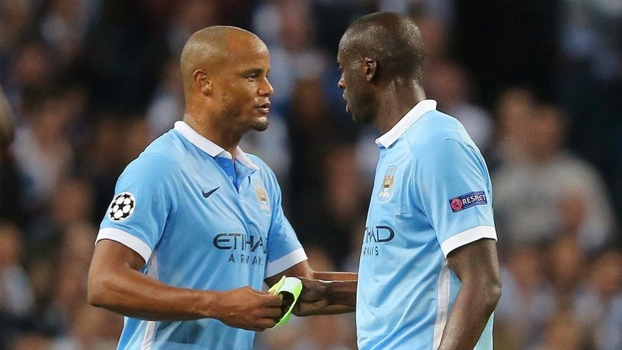 MANCHESTER, ENGLAND - SEPTEMBER 15: Vincent Kompany hands the captains arm band to Yaya Toure of Manchester City during the UEFA Champions League Group D match between Manchester City FC and Juventus at the Etihad Stadium on September 15, 2015 in Manchester, United Kingdom. (Photo by Matthew Ashton - AMA/Getty Images)