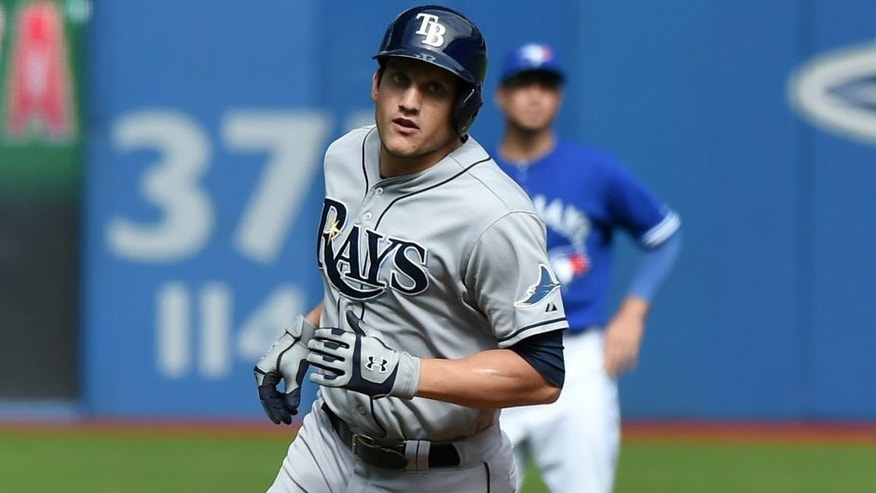 Sep 27, 2015; Toronto, Ontario, CAN; Tampa Bay Rays center fielder Mikie Mahtook (27) rounds the bases after hitting a two-run home run against Toronto Blue Jays in the third inning at Rogers Centre. Mandatory Credit: Dan Hamilton-USA TODAY Sports
