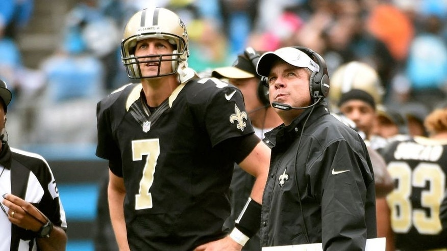 Sep 27, 2015; Charlotte, NC, USA; New Orleans Saints quarterback Luke McCown (7) and head coach Sean Payton on the sidelines in the fourth quarter. The Panthers defeated the Saints 27-22 at Bank of America Stadium. Mandatory Credit: Bob Donnan-USA TODAY Sports