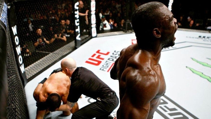 SAITAMA, JAPAN - SEPTEMBER 27: Uriah Hall of Jamaica celebrates his win over Gegard Mousaasi of Iran in their middleweight bout during the UFC event at the Saitama Super Arena on September 27, 2015 in Saitama, Japan. (Photo by Mitch Viquez/Zuffa LLC/Zuffa LLC via Getty Images)