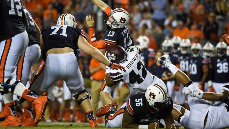 Sep 26, 2015; Auburn, AL, USA; Auburn Tigers quarterback Sean White (13) is tackled by Mississippi State Bulldogs linebacker Beniquez Brown (42) while trying to pass during the fourth quarter at Jordan Hare Stadium. Mississippi State defeated Auburn 17-9. Mandatory Credit: Shanna Lockwood-USA TODAY Sports