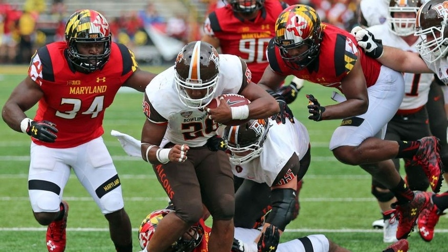 Sep 12, 2015; College Park, MD, USA; Bowling Green Falcons running back Fred Coppet (28) gains yardage before being tackled by diving Maryland Terrapins defensive back William Likely (4) at Byrd Stadium. Mandatory Credit: Mitch Stringer-USA TODAY Sports